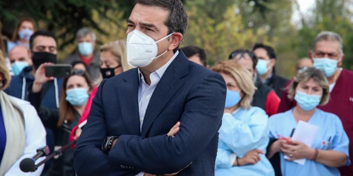 Tsipras maska stavromena xeria